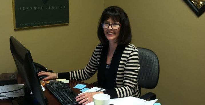 Executive Director Kit Parks sitting at her desk