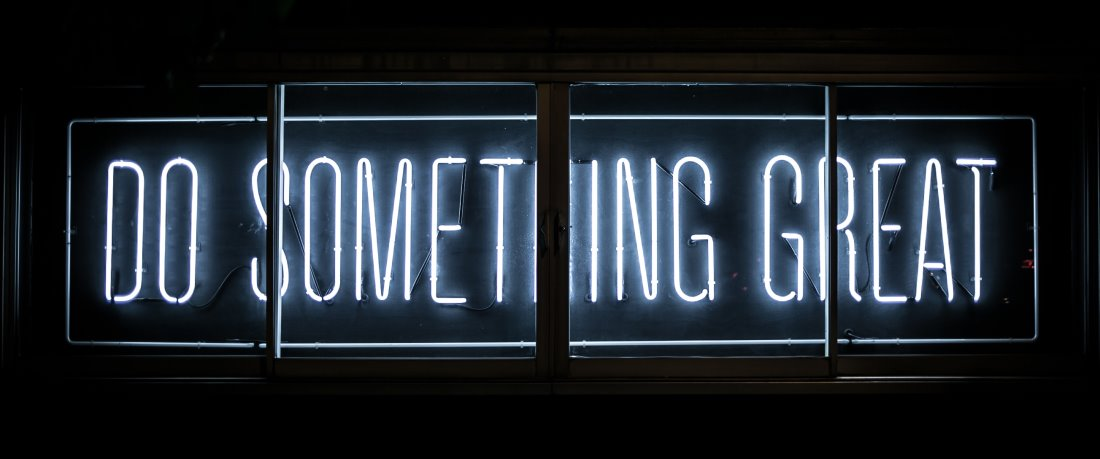 """Neon sign that reads, """"Do Something Great"""""""